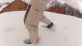 Mountaineer walking in snow stock video footage