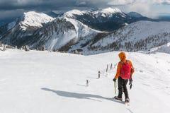Mountaineer walking on the snowy slope. Of the Dovska Baba mountain in Karavanke range, Slovenia Stock Photos