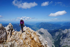 Mountaineer woman on top of a mountain Royalty Free Stock Image