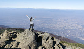 Mountaineer woman on top of a mountain. Looking the city of ,Bulgaria Royalty Free Stock Images