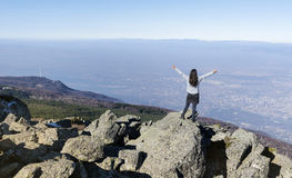 Mountaineer woman on top of a mountain. Looking the city of Sofia,Bulgaria Royalty Free Stock Image