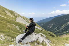 Mountaineer woman on top of a mountain Stock Images