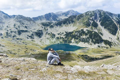 Mountaineer woman on top of a mountain. Mountaineer woman on top of Pirin mountain ,Vihren peak,Bulgaria royalty free stock photos