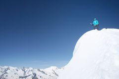 Mountaineer women on a summit. Mountaineer woman on a summit of a high mountain of Weissmies. Feeling of a success Royalty Free Stock Photo