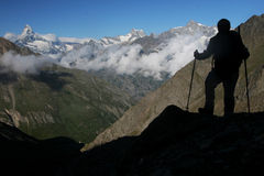 Mountaineering. Outdoor activity - silhouette of a mountaineer Royalty Free Stock Image