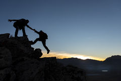 Mountaineering aid. Unusual climbers on the mountains Stock Images