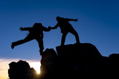 Mountaineering assistance. And victory on peak Royalty Free Stock Image