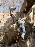 Mountaineering climbing competition. A pair of climber on the mountaineering climbing competition Royalty Free Stock Photo