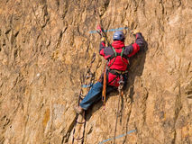 Mountaineering competition. With climber hanging on the rock Royalty Free Stock Image