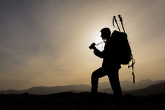 Mountaineering guide silhouette Royalty Free Stock Photo
