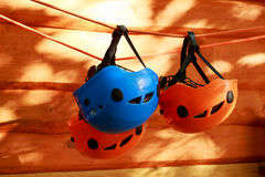 The mountaineering helmets. The several mountaineering helmets suspended on a rope Royalty Free Stock Photos