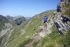 Mountaineering. Man trekking in high mountains - Fagaras, Romania Stock Photo
