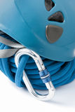Mountaineering safety equipment. With a rolled blue braided polyester climbing rope, safety helmet and aluminium karabiner or connecting clip Stock Photography