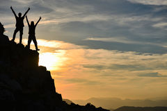 Mountaineering;successful climbers at the summit Royalty Free Stock Photography