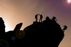 success & team spirit & Mountaineering at sunset Royalty Free Stock Images