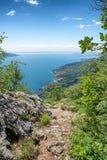 Mountaineering trail above garda lake with beautiful lake view Stock Image