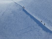 Mountaineers on Monte Rosa, Italy. Mountaineers ascending/descending a steep section on a glacier in Monte Rosa, Italy royalty free stock photography