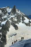 Mountaineers climbing to Aiguille du midi Royalty Free Stock Images