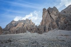 Mountaineers descend from Fontananegra pass in a wonderful rocky scenario. Cortina d`Ampezzo, Italy stock photo