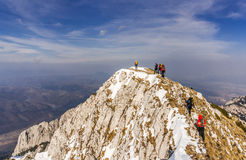 Mountaineers lined up along the ridge. Stock Photo
