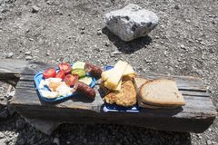 Snack. Mountaineers snack on wood outdoors in summer Stock Photo