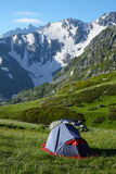 Mountaineers tent on meadow in the mountains Stock Images