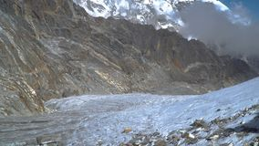 Mountaineers walk through the glacier in the Himalayas. Nepal. 4K stock video footage