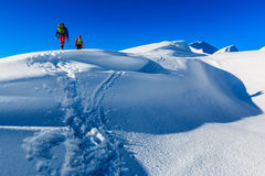 Mountaineers walking on the mountain ridge Royalty Free Stock Images