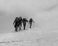 The mountaineers. Walking towards the top of the summit stock photography