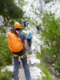Mountaineers walking up along a ridge with the backpack on expedition to Alps royalty free stock image