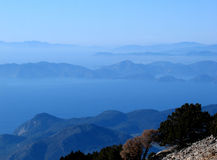 Mountainous coastline in silhouette Stock Image