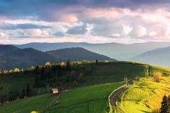 Mountainous countryside in evening light stock photos