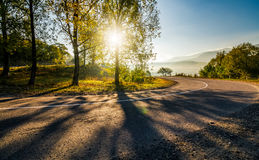 Mountainous countryside road at sunrise Stock Photo