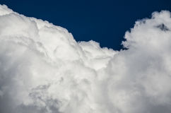 Mountainous Cumulus Clouds Boiling in the Bright Blue Summer Sky. Mountainous White Cumulus Clouds Boiling in the Bright Blue Summer Sky Royalty Free Stock Photos