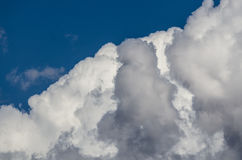 Mountainous Cumulus Clouds Boiling in the Bright Blue Summer Sky. Mountainous White Cumulus Clouds Boiling in the Bright Blue Summer Sky Stock Photography