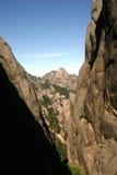 Mountainous gorge. Scenic view of mountainous gorge or canyon with blue sky background Royalty Free Stock Image