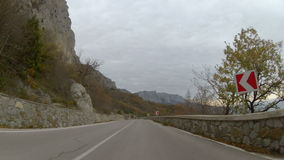 Mountainous highway in late autumn, GoPro. Trip up to the mountains by the highway, GoPro stock video