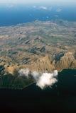 Mountainous island. View from the plane Royalty Free Stock Photo