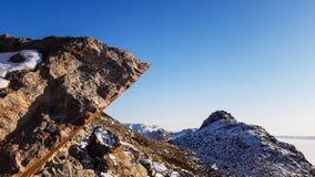 Mountainous landforms and rocks. Blue sky stock photo