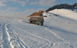 Winter mountain landscape. Snow and cottage at high altitude - Ciucas Mountains, landmark attraction in Romania Stock Image