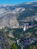 Mountain Landscape with a Waterfall in Yosemite. The mountainous landscape and iconic waterfall at Yosemite National Park taken from Glacier Point stock images