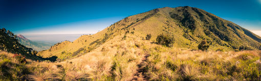 Mountainous landscape in Indonesia. Panoramic photo of mountain near Mount Merbabu near Yogya in central Java province in Indonesia. In this region, one can only Stock Photos