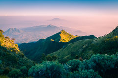 Mountainous landscape in Java. Photo of mountains surrounding Mount Merbabu in morning sunlight near Yogya in central Java province in Indonesia. In this region Royalty Free Stock Image