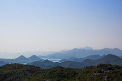 The mountainous landscape: the mountains, the sky, mountain lakes, heavenly gradient. Silhouette of the mountains against the sky Stock Photos