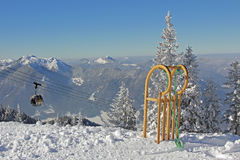 Mountainous landscape with ropeway and long horn sledge royalty free stock photo