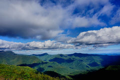 Mountainous landscape. Scenic view of a mountainous landscape with blue sky and clouds Royalty Free Stock Images