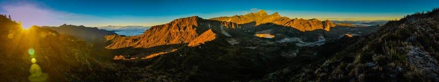 Mountainous landscape in Trikora. Panoramic photo of mountainous landscape in morning sunlight during sunrise in Trikora, Papua, Indonesia. This is very remote Stock Photos