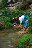 Washing thread fibre on the stone-plateau of mountainous people Royalty Free Stock Images