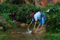 Washing thread fibre on the stone-plateau of mountainous people Stock Photography