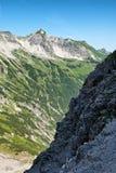 Mountainous scenery with two steep slopes, Alps Stock Photo